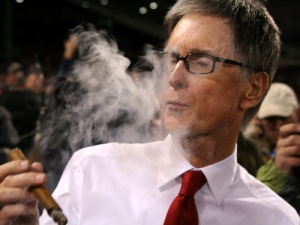 John Henry, soaking in the sweet aroma of victory